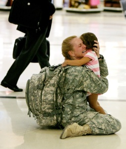 Image credit: Louie Favorite Terri Gurrola is reunited with her daughter after having served in Iraq for seven months.
